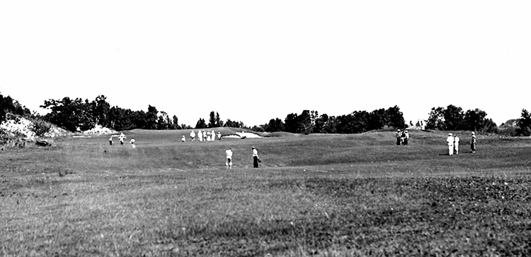black and white photograph of golfers at Manistee Golf and Country Club located on the Shores of Lake Michigan